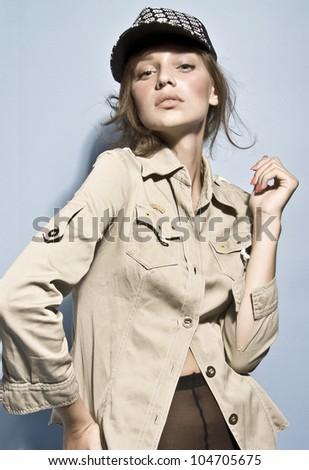 caucasian model posing with cap in studio