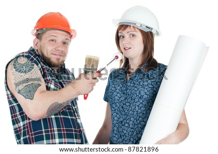 Caucasian muscular manual worker with working tools and female architect with blueprints, white background