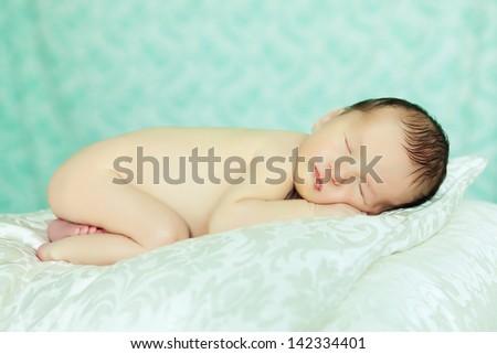 Caucasian newborn baby while sleeping closeup