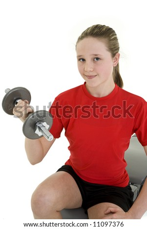 Caucasian preteen female lifting weights using a dumbbell on a white background