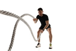 Caucasian professional sportsman training isolated on white studio background. Muscular, sportive man practicing.