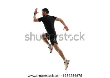 Caucasian professional sportsman training isolated on white studio background. Muscular, sportive man practicing. Stock photo ©