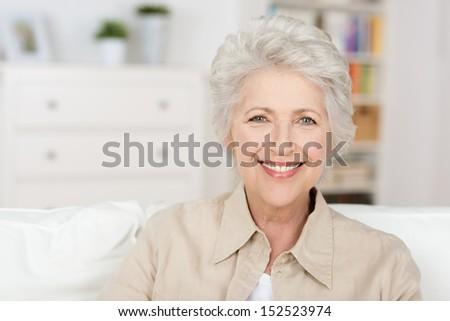 Caucasian senior beautiful woman enjoying the retirement home in her living room