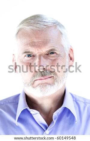 caucasian senior man portrait puckering sullen isolated studio on white background