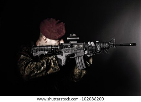 caucasian soldier with rifle dark background