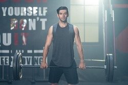Caucasian Sportsman exercise to maintain muscle and biceps in gym club. Athlete active Bodybuilder man fitness trainer workout by lift up weight lifting or barbell for health care activity in stadium.