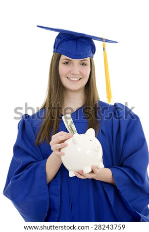 Caucasian teenager wearing a blue graduation gown and holding a piggy bank isolated on a white background.  Illustrating the high cost of education