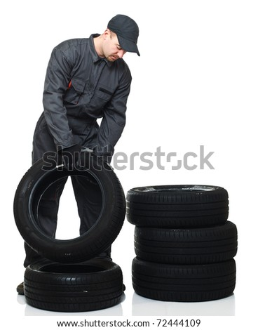 caucasian tire repairer on duty isolated on white background