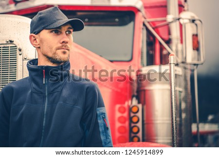 Caucasian Trucker in His 30s Portrait. Truck Driving and Logistics Industry.  #1245914899