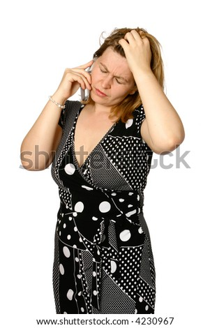 Caucasian woman appearing distress while on her cellphone, isolated.