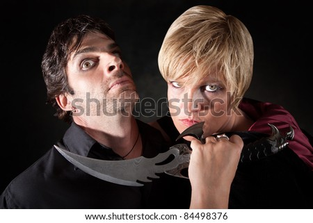 Caucasian woman attacks man with large athame knife