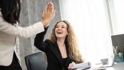 caucasian woman happy smile and hand high five with teamwork coworker