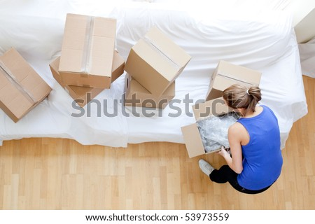 Caucasian woman holding a box at home