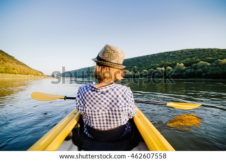 Caucasian woman is relaxing in kayak on the river. Ukraine. #462607558