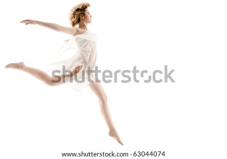 Caucasian woman jumping, dancing  on white background