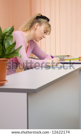 Caucasian woman receptionist write a note