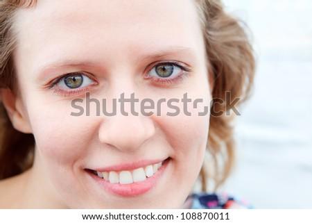 Caucasian woman smiling clean face close up. Copy space