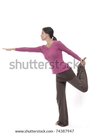 Caucasian woman stretching. Photographed in studio.