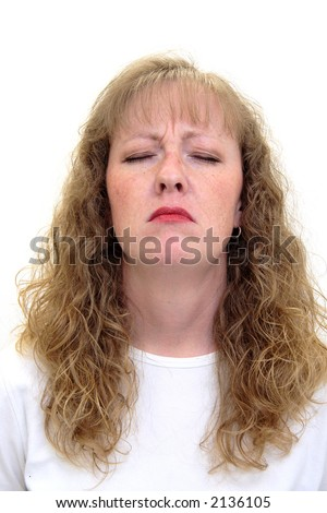 Caucasian woman with her eyes closed looking very depressed and unhappy. Isolated on white.