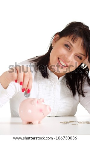 Caucasian woman with piggy bank sitting on a light background
