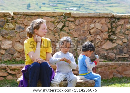 Caucasian woman with two children in the countryside. Interracial family.