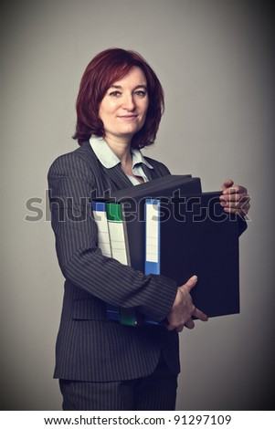 caucasian worker holding file folder