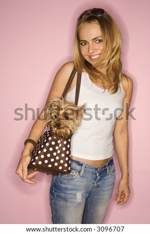 stock photo : Caucasian young adult female with Yorkshire Terrier dog in bag ...