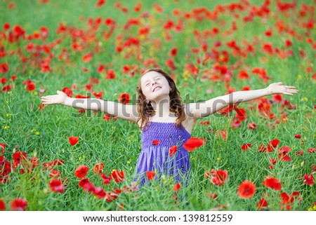Caucasian young child feel the fresh air in flower field