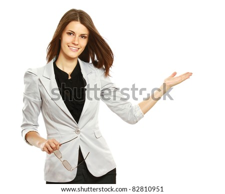 Caucasian young female mode in suit pointing at something.