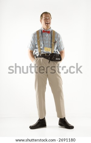 Caucasian young man dressed like nerd smiling with eyes closed.
