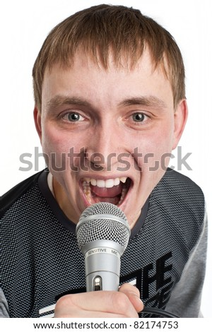 Caucasian young man singing into a microphone, singer, isolated over white