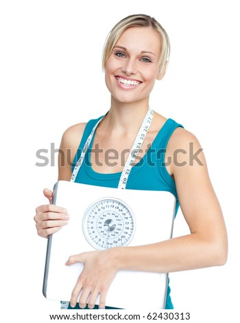 Caucasian young woman holding a weight scale looking at the camera over white background