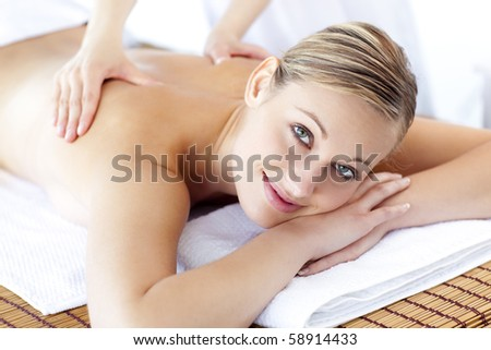 Caucasian young woman receiving a health treatment in a spa center