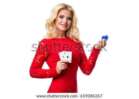 Caucasian young woman with long light blonde hair in evening outfit holding playing cards and chips. Isolated. Poker