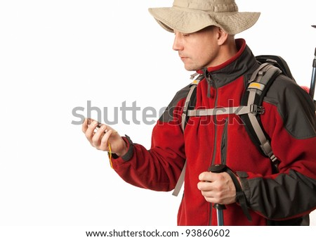caucasion male hiker on white backround holing a compass - stock photo