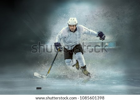 Caucassian ice hockey Players in dynamic action in a professional sport game play in hockey under stadium lights.