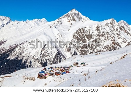 Caucasus Mountains, Panoramic view of the ski slope  on the horizon in winter day. Dombai ski resort, Western Caucasus, Karachai-Cherkess, Russia.