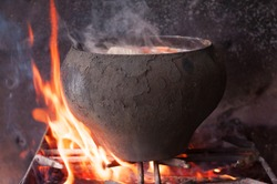 Cauldron on fire. cast iron old. soup