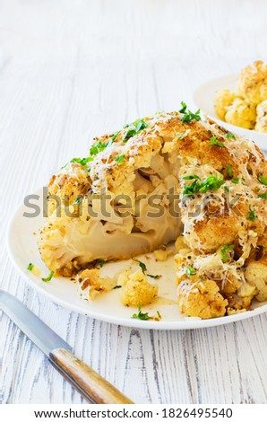 Cauliflower baked in the oven with parmesan cheese closeup. Selective focus Foto d'archivio ©