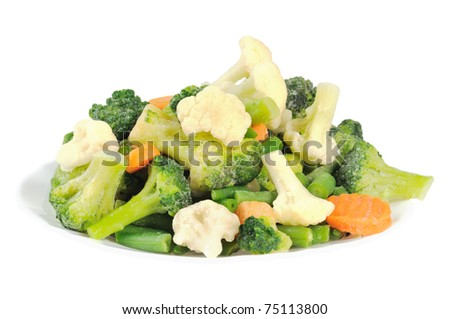 Cauliflower, broccoli, carrots and beans on a plate. Isolated on white.