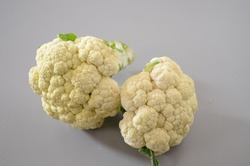 Cauliflower is one of several vegetables in the species Brassica oleracea in the genus Brassica.  Vegetable. The edible white flesh sometimes called ''curd''. Annual plant.