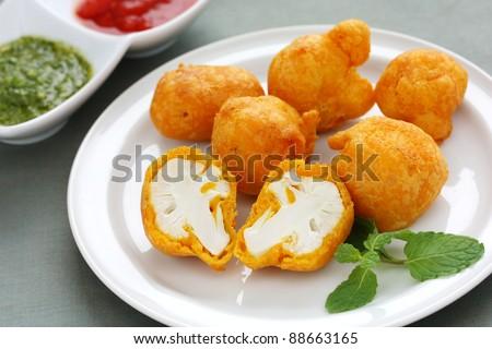 cauliflower pakora , indian fritter cuisine - stock photo