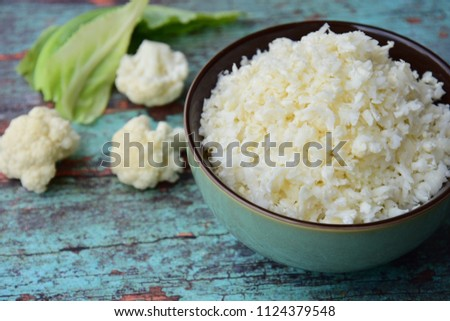 Cauliflower rice on green wooden background, selective focus Сток-фото ©