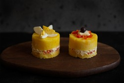 Causa limeña is a typical dish from Peru and whose ingredients are potatoes, yellow chili, mayonnaise, red peppers and pieces of chicken or fish and is served as a starter.