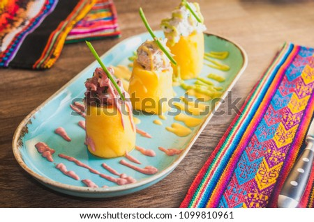 Causa traditional peruvian food colorful