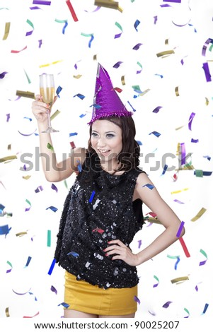 Causcasian woman with champagne having fun in the party wearing pary hat