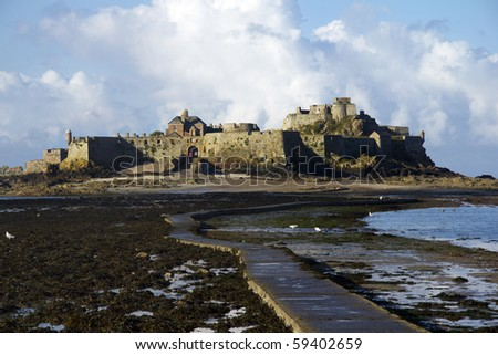 Causeway to Elizabeth Castle, Jersey - stock photo