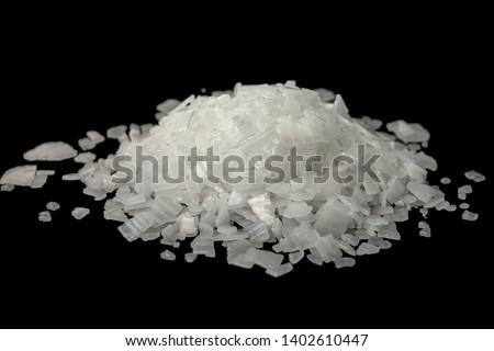 Caustic soda,Sodium Hydroxide isolate on black background