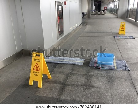 Caution about wet floor on sky train station #782488141