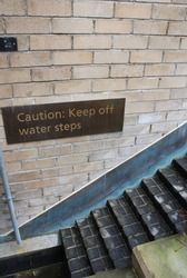 Caution sign for warning people to keep off from water steps in Sydney city